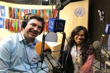 Jason DeWall (left) and Sinduja Srinivasan, hosts of the new UN News podcast, UNcomplicated.