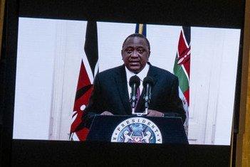 President Uhuru Kenyatta (on screens) of Kenya addresses the general debate of the UN General Assembly's 76th session.