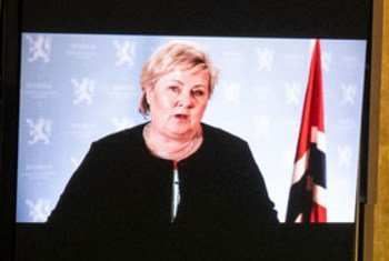 Prime Minister Erna Solberg (on screens) of Norway addresses the general debate of the UN General Assembly's 76th session.
