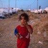 Une fillette de quatre ans erre dans le camp de Bardarash à Duhok, en Iraq. Elle fait partie des plus de 7.000 réfugiés syriens qui ont fui les combats dans le nord-est de leur pays.
