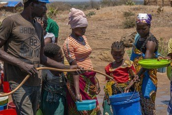 Displaced people queue for water at Metuge, Cabo Delgado Province, Mozambique.