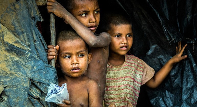 Young Rohingya boys look out of their shelter at the Hakimpara refugee camp in Cox's Bazar, Bangladesh.