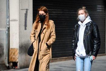 Two women walk in the Taksim district of Istanbul, Turkey.
