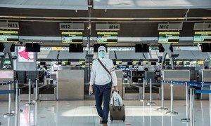 A solitary passenger at Suvarnabhumi Airport, Bangkok, Thailand.