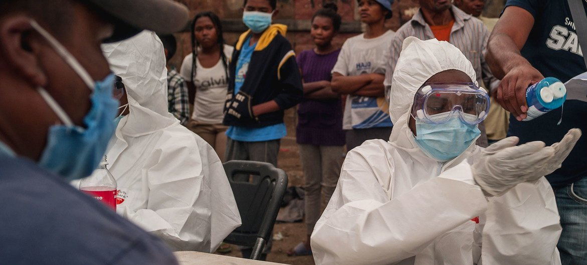 Health workers in Madagascar test citizens for COVID-19.