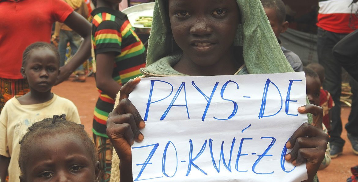 A young girl holds a sign which says Zo Kwe Zo, Central African Republic's national motto, meaning all human beings are equal (file photo).