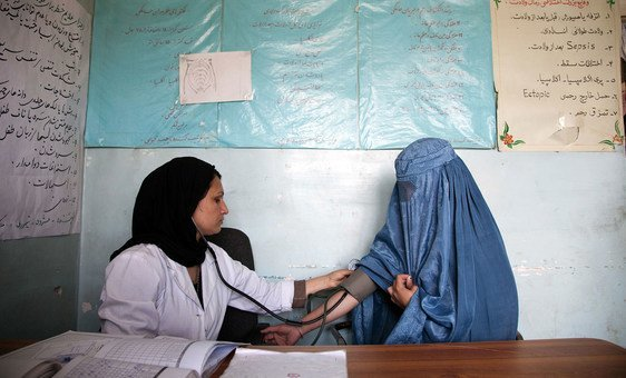 A midwife at a medical health clinic in Parwan Province, Afghanistan, checks the blood pressure of a 22-year-old woman. (file)