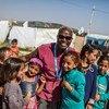UNICEF Goodwill Ambassador Angelique Kidjo engages with children in the Housh el Refka informal settlement, in Lebanon's Bekaa Valley.
