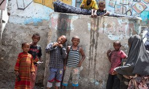 Children wait to be vaccinated against polio in the back streets of Mogadishu, Somalia.