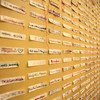 Labels with the names of victims of femicide, as well as the 'unknown'  represent the victims of femicide at an exhibition in Mexico.
