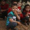 Niños sirios en un campamento improvisado en Aqrabat, a 45 kilómetros de Idlib.