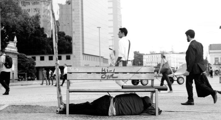 A homeless person sleeps on the streets of Rio de Janeiro.