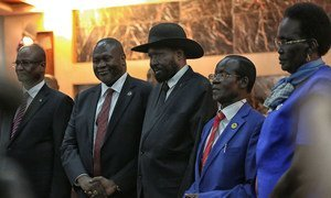 Salva Kiir, President of South Sudan, (centre right) shakes hands with Riek Machar, who was sworn in as  First Vice President of the new Transitional Government of National Unity on 22 February 2020.