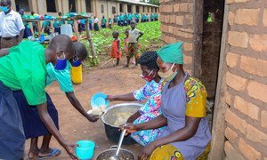 Students receiving meals at a school in northern Uganda.
