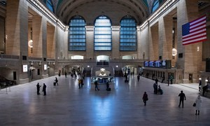 A wide view of Grand Central Terminal with an unusually sparse crowd during the Coronavirus (COVID-19) outbreak in New York City.