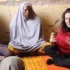 OCHA's Reena Ghelani (right) meets women in Teachers Village IDP Camp in Maiduguri in northeastern Nigeria.