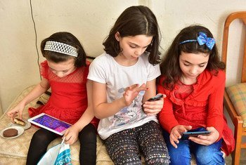 Young girls in Turkey use their digital devices.