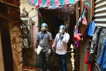 Health workers conduct a COVID-19 vaccination awareness campaign in a neighbourhood in Mumbai, India.