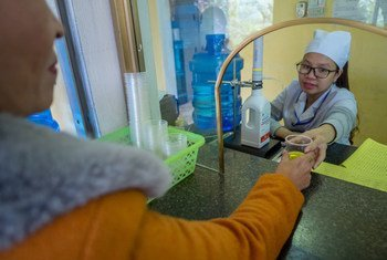 Methadone is dispensed by a nurse to a former heroin addict in Viet Nam.