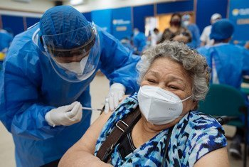 A Venezuelan refugee receives her first dose of the COVID-19 vaccine in Guayaquil, Ecuador.