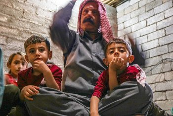 Elias and his family, Yazidis who were heavily persecuted under ISIL, sit on the floor of their home in Zakho, northern Iraq.
