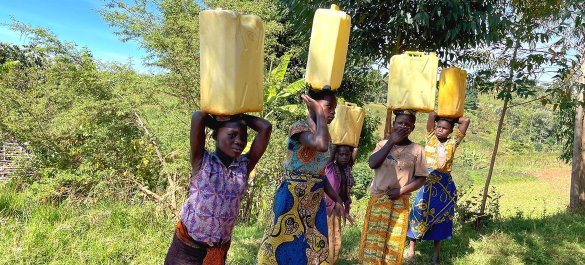 Young girls carry water from a source in Ituri in the Democratic Republic of the Congo.