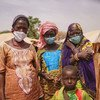In Niger attacks by armed groups have been on the rise, exacerbating the plight of communities reeling under the impact of the pandemic. Pictured here, a woman with members of her family, who were forced to flee their homes due to violence and insecurity.