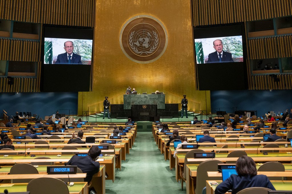 President Michel Aoun (on screens) of Lebanon addresses the general debate of the UN General Assembly's 76th session.