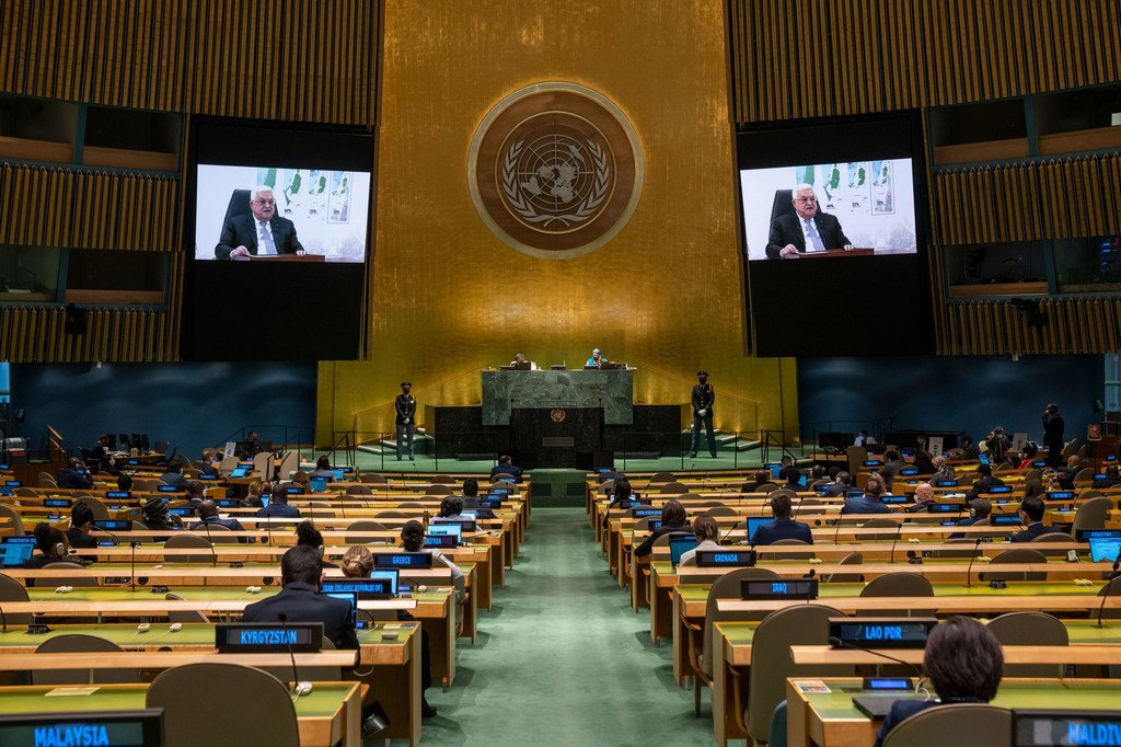 President Mahmoud Abbas (on screens) of the State of Palestine addresses the general debate of the UN General Assembly's 76th session.