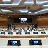 Les délégués observent la distanciation sociale lors de la Conférence sur l'Afghanistan de 2020 au Palais des Nations des Nations Unies à Genève (archive)