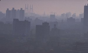 Pollution fills the skyline of the Chinese city of Shanghai at dusk.