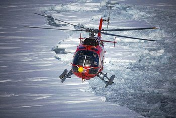 Amidst record-high temperatures, a helicopter flying over the arctic observes a planet that is changing at an unprecedented pace.