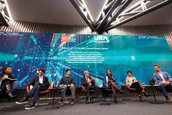 Secretary-General António Guterres (center) sits down for a dialogue during a UN75 event with youth rights activists at The Graduate Institute in Geneva.