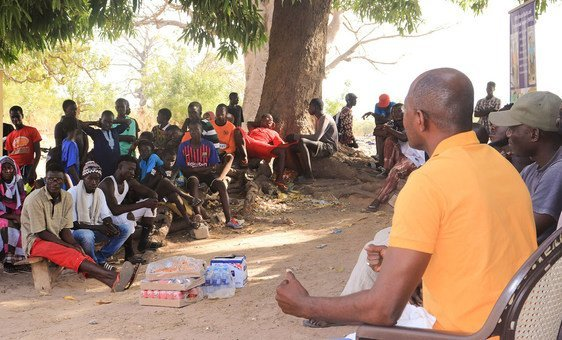Community members participate in a traditional 'bantaba' session
