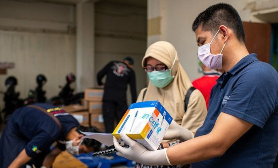 Medical equipment supplied by UNICEF is checked at a warehouse in Indonesia.