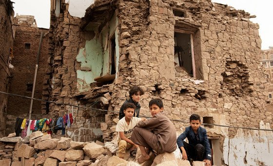 Children sit in front of a house damaged by an air strike, inside the old city of Sana'a, Yemen. (file)
