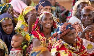 Women attend a community meeting in Cameroon.