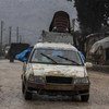 Une famille arrive à Afrin, dans le nord du gouvernorat d'Alep, après avoir fui les violences à Idlib en Syrie (photo d'archives).