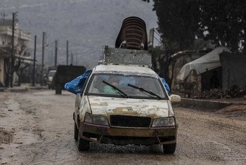 A family arrives in Afrin in northern Aleppo governorate in Syria after escaping conflict in rural Idlib. (file)
