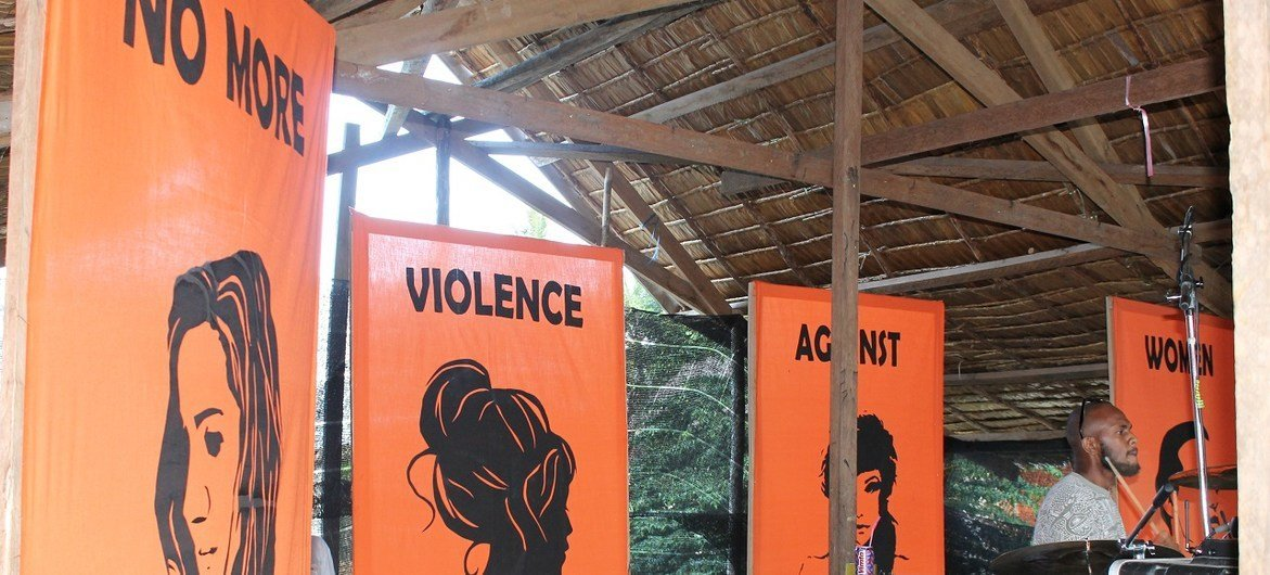 """A stage at a youth festival in the Solomon Islands sending a strong message: """"NO MORE VIOLENCE AGAINST WOMEN AND GIRLS"""""""