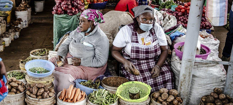 Women vendors sell fresh vegetables at a market in Limuru, Kenya.