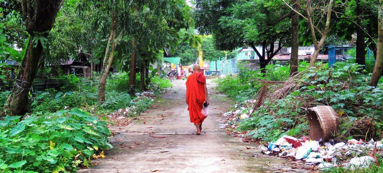 A monk walks towards the Pagoda near Yangon, Myanmar.