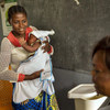 Twenty-six year old Mama Bwanga takes her baby to at a health centre in the Democratic Republic of the Congo (DRC).