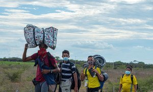 Venezuelan refugees make their way to the Colombian border town of La Guajira.