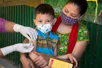 A young boy is vaccinated against measles and rubella during a national vaccination campaign in Bangladesh.