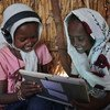 Children use their tablet at a UNICEF supported learning centre in a village on the outskirts of Kassala, in Eastern Sudan.