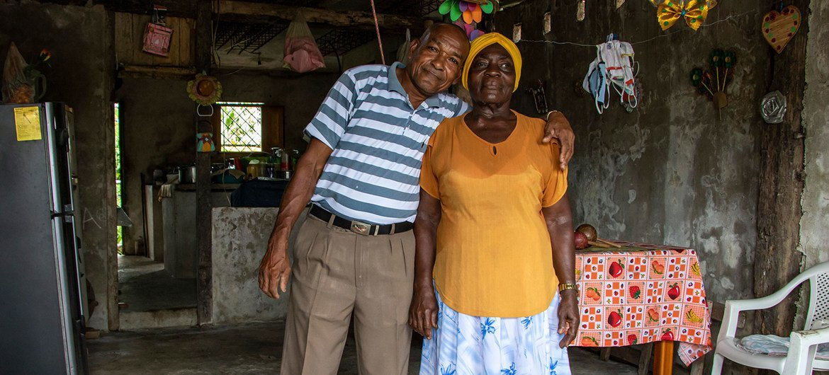 Colombian refugee Agapito Escobar with his wife, Wilma, at home in San Lorenzo, Ecuador.