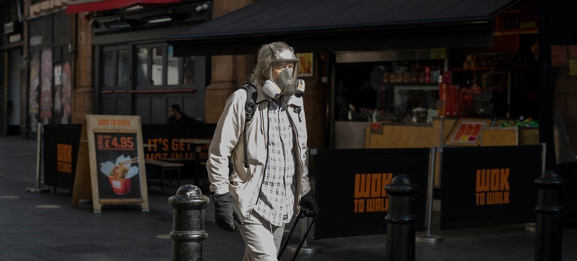 A masked antheral   walking successful  London's West End