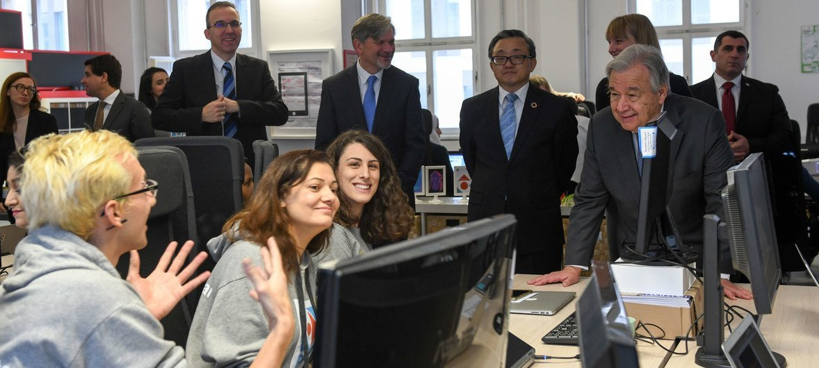 UN Secretary-General António Guterres (right) interacts with students of ReDi School for Digital Integration in Berlin,  Germany.