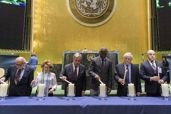 A candle lighting ceremony takes place at the United Nations Holocaust Memorial Ceremony